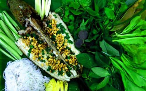 Cá lóc nướng trui ở Sài Gòn hương vị ẩm thực miền Tây